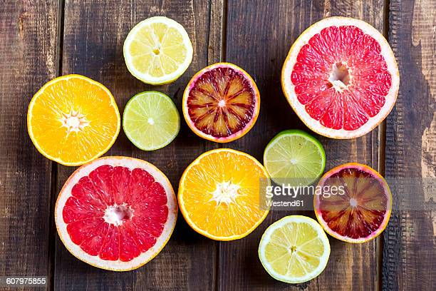 Sliced citrus fruits on wood