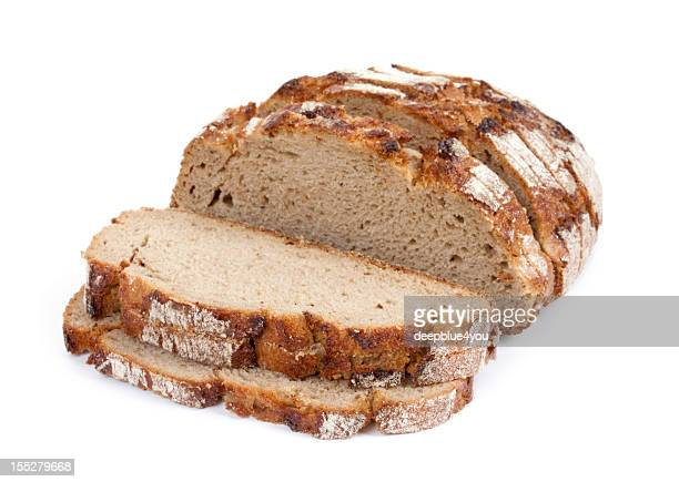 sliced crusty whole grain bread isolated on white - loaf of bread stock pictures, royalty-free photos & images