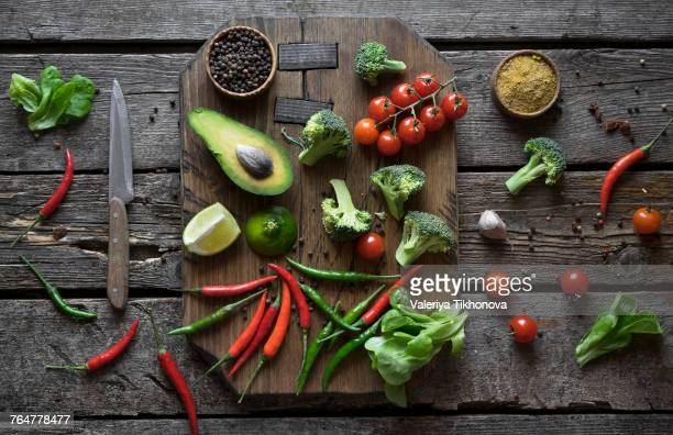 Sliced fruit and vegetables on cutting board