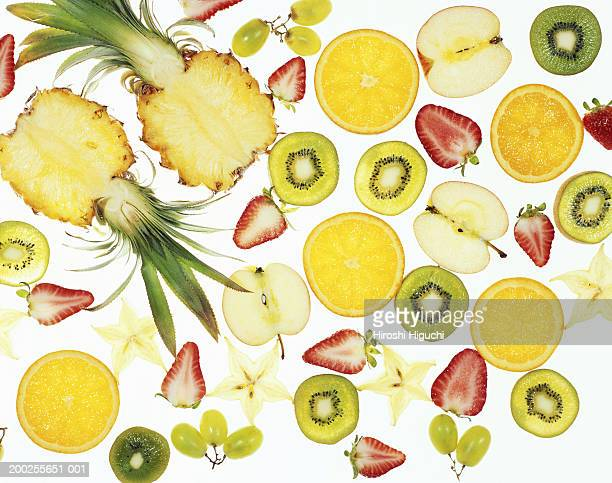 Sliced fruit on illuminated white surface, full frame