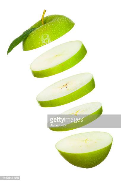 Sliced Green Apple Slices tossed in Air