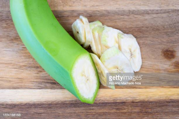 sliced green banana fruit over cutting board - unripe stock pictures, royalty-free photos & images