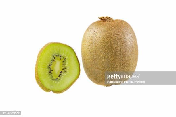 sliced kiwi fruit on white background - kiwi fruit stock pictures, royalty-free photos & images