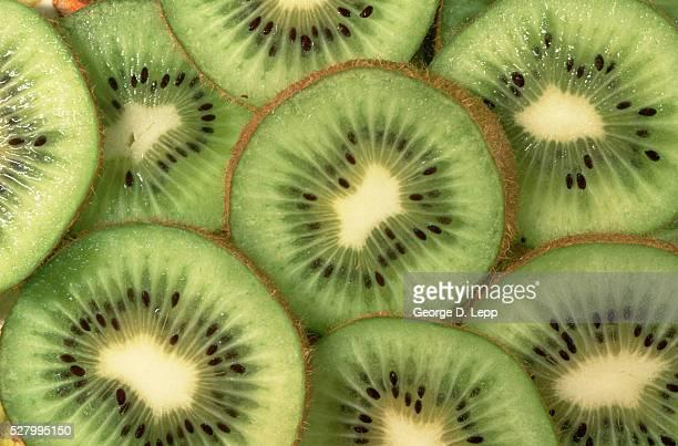 sliced kiwi fruit - kiwi fruit stock pictures, royalty-free photos & images