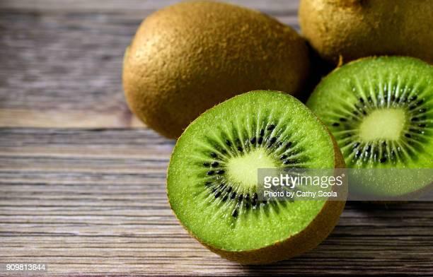 sliced kiwi - kiwi fruit stock pictures, royalty-free photos & images