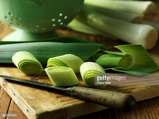 Sliced leeks on chopping board, close-up