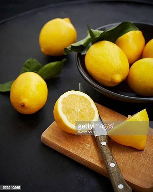 Sliced lemons in chopping board