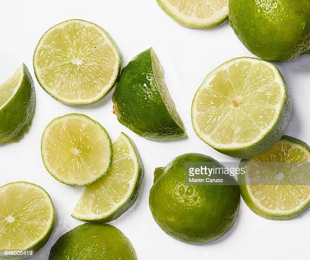 Sliced limes on white surface