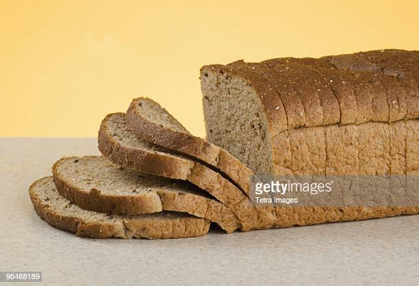 sliced loaf of bread - loaf of bread stock pictures, royalty-free photos & images