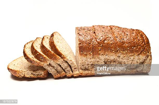 sliced loaf of seeded brown bread - loaf of bread stock pictures, royalty-free photos & images