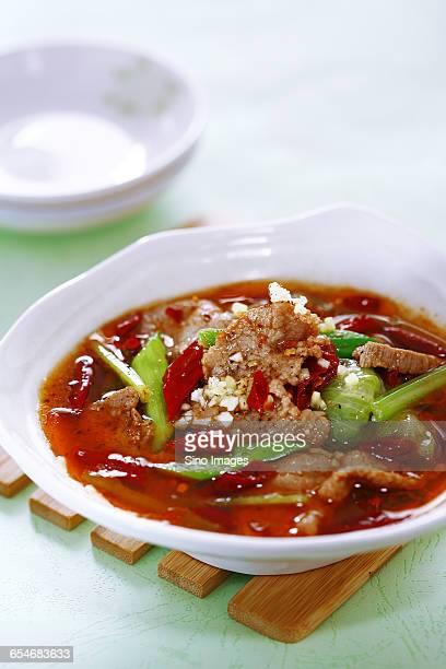 Sliced Meant with Green Vegetable in Hot Spicy Water