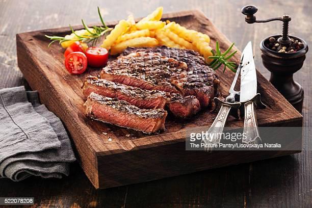 Sliced medium rare grilled Steak Ribeye Black Angus with french