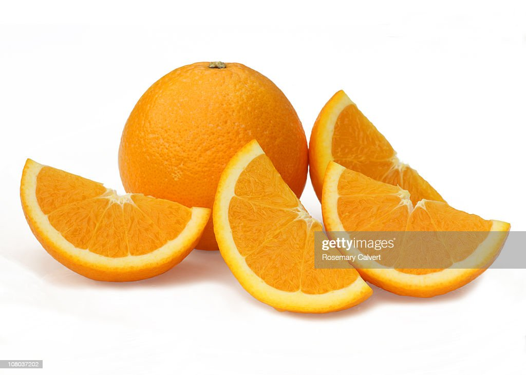 Sliced orange quarters and whole orange. : Stock Photo