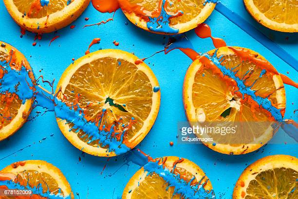 Sliced oranges and paint background