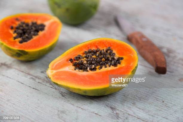 sliced papaya on wood - papaya stock photos and pictures