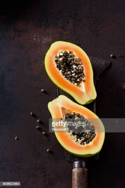 sliced papaya - papaya stock photos and pictures