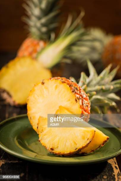 Sliced Pineapple on Wooden Background