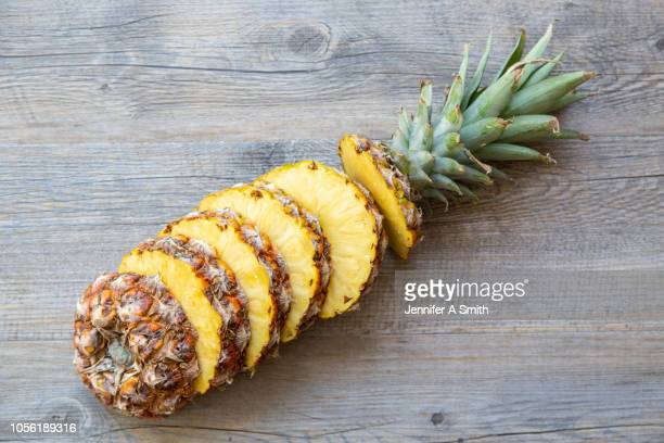 sliced pineapple - pineapple stock pictures, royalty-free photos & images