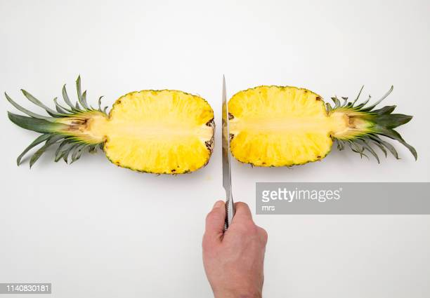 sliced pineapple - halved stock pictures, royalty-free photos & images