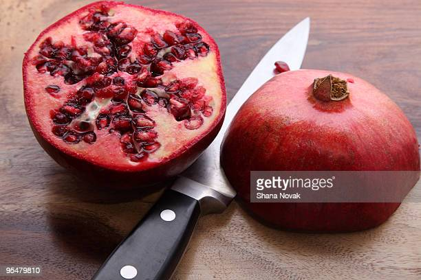 Sliced Pomegranate With Knife