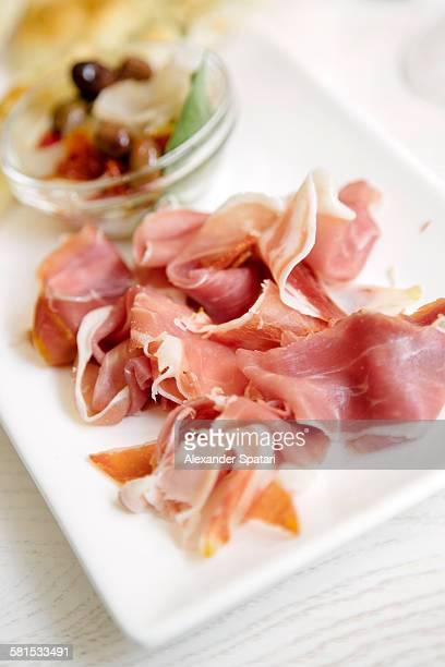 Sliced prosciutto on a plate
