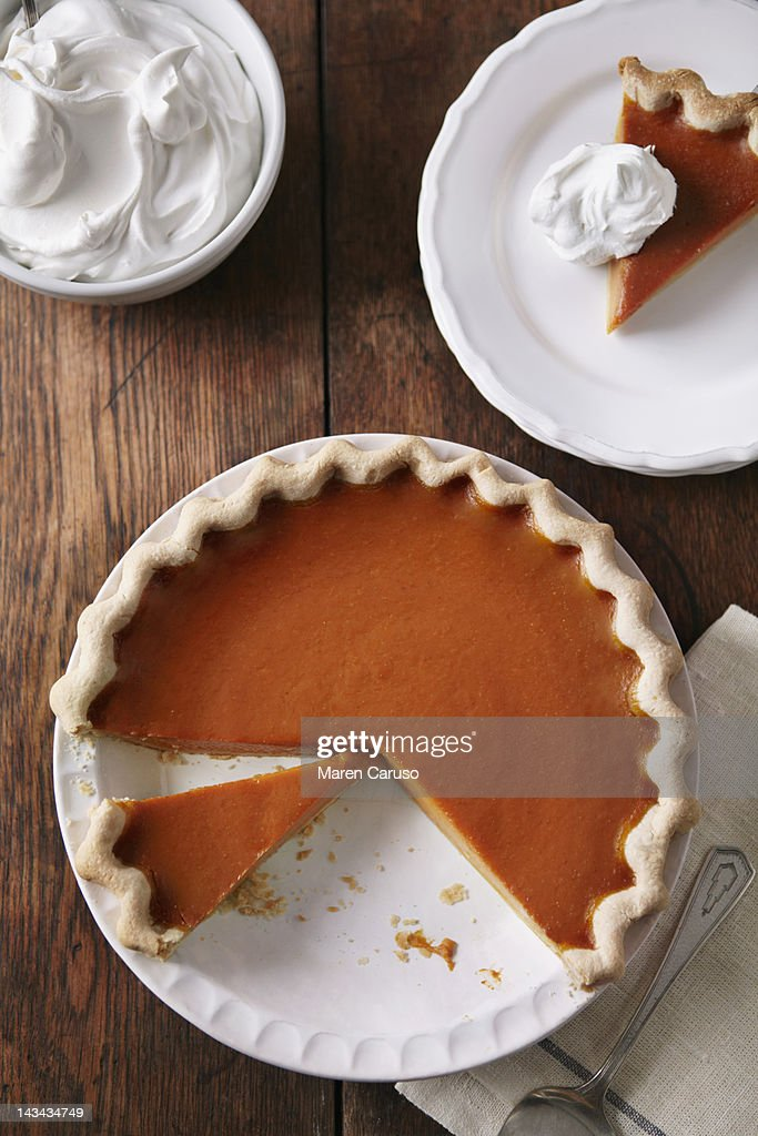 Sliced pumpkin pie on wood table, from above : Stock Photo