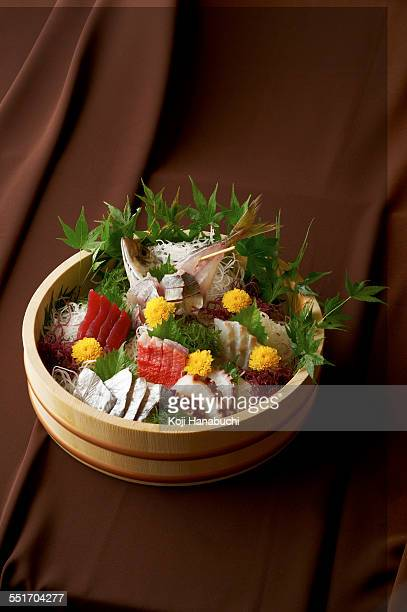 Sliced raw fish in bowl