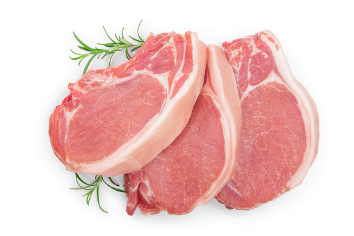 sliced raw pork meat with rosemary isolated on white background. Top view. Flat lay 1162194568