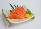 Sliced raw Salmon sashimi on plate