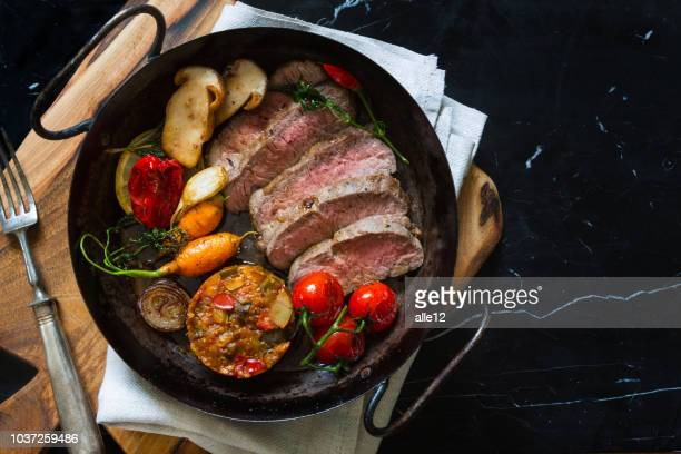 sliced roast beef on pan - french food stock pictures, royalty-free photos & images
