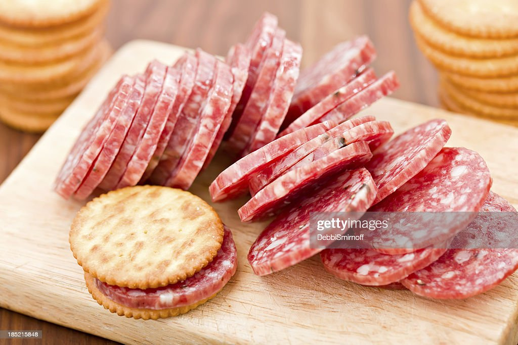 Sliced Salami And Crackers : Stock Photo