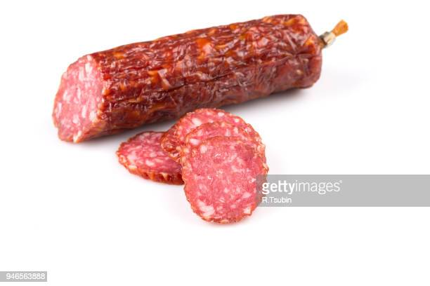 sliced salami isolated on a white background - pepperoni stock photos and pictures