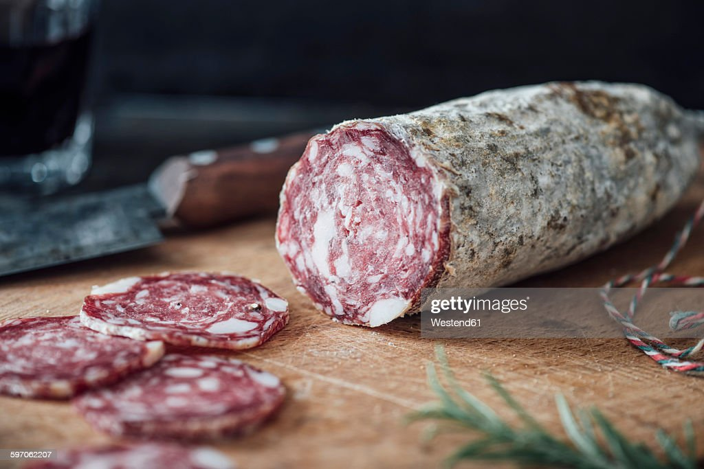 Sliced salami on cutting board : Stock Photo