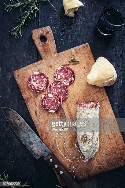 sliced salami on cutting board - pepperoni stock photos and pictures