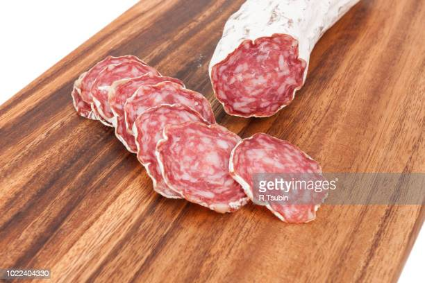 sliced salami on wooden board and white background white background