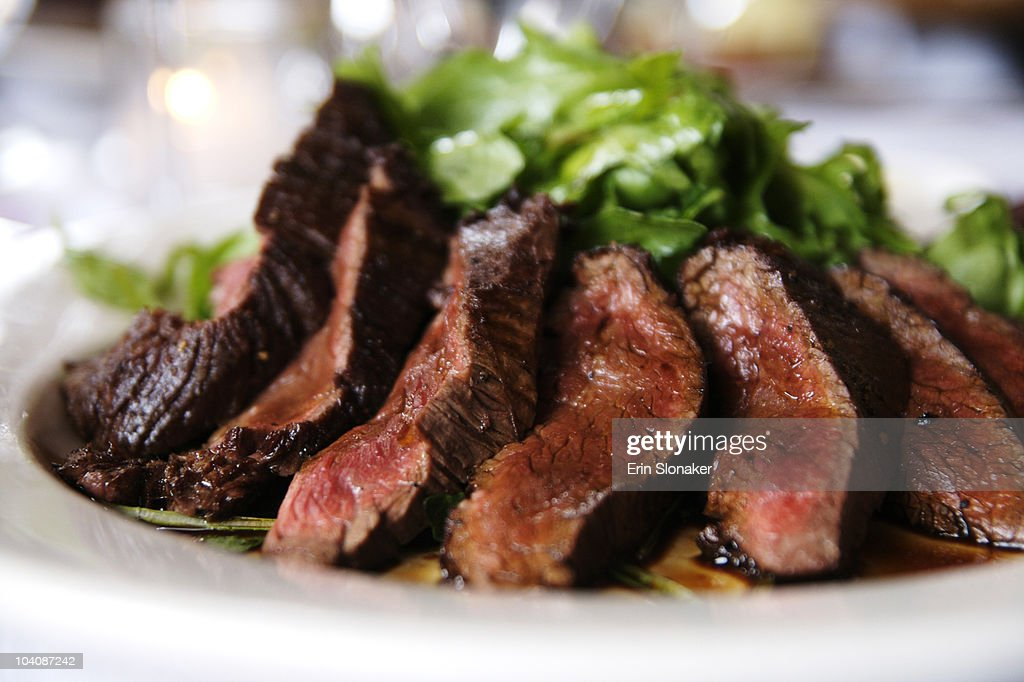Sliced steak on a plate.  Delicious. : Stock Photo