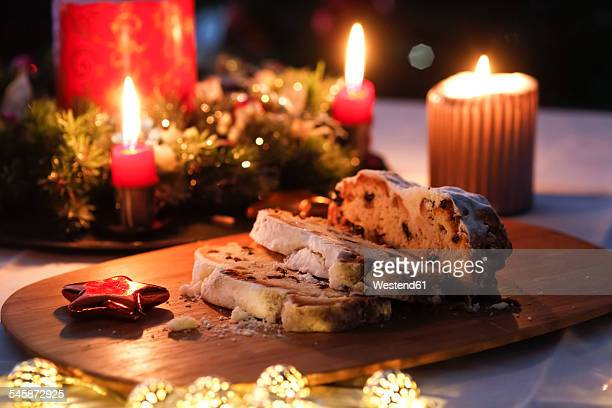 Sliced Stollen and lighted candles at Advent season
