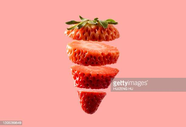 sliced strawberry on pink background. fresh cut strawberry. - strawberry stock pictures, royalty-free photos & images