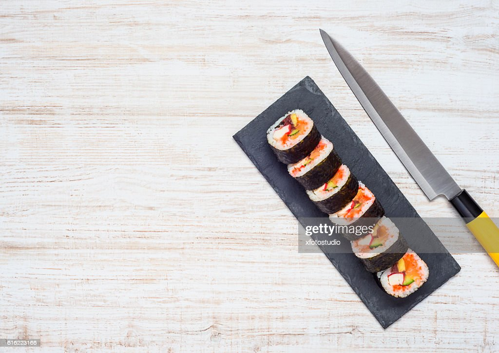 Sliced Sushi and Knife With Copy Space : Stock Photo