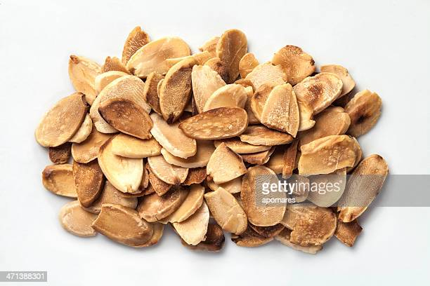 Sliced toasted almonds on white background