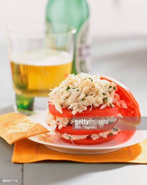 Sliced tomato with crab salad