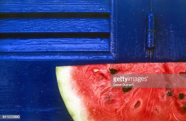 Sliced Watermelon against Blue Shutters
