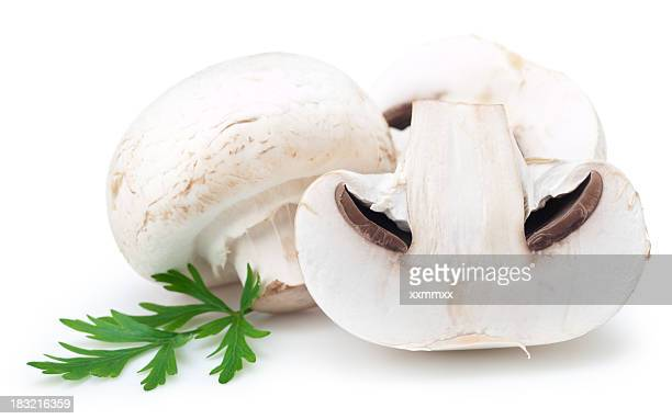 Sliced white mushrooms on a white background