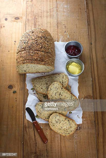 Sliced whole grain bread loaf on table