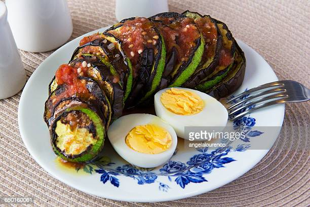 Sliced zucchini and eggplant with hard boiled eggs