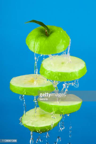 wet slices fresh apple tossed air