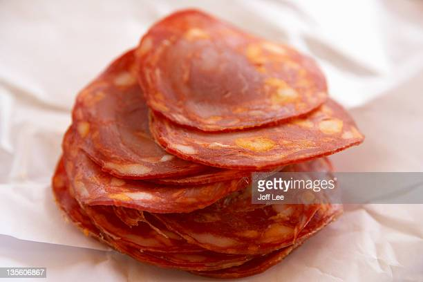 slices of chorizo - chorizo stock pictures, royalty-free photos & images