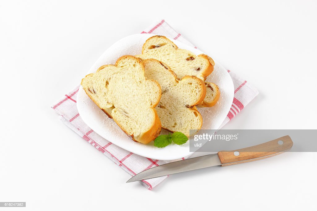 slices of Christmas sweet braided bread : Stock-Foto