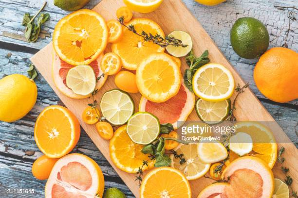 slices of citrus fruit on cutting board - vitamin c stock pictures, royalty-free photos & images