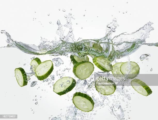 Slices of cucumber falling into water